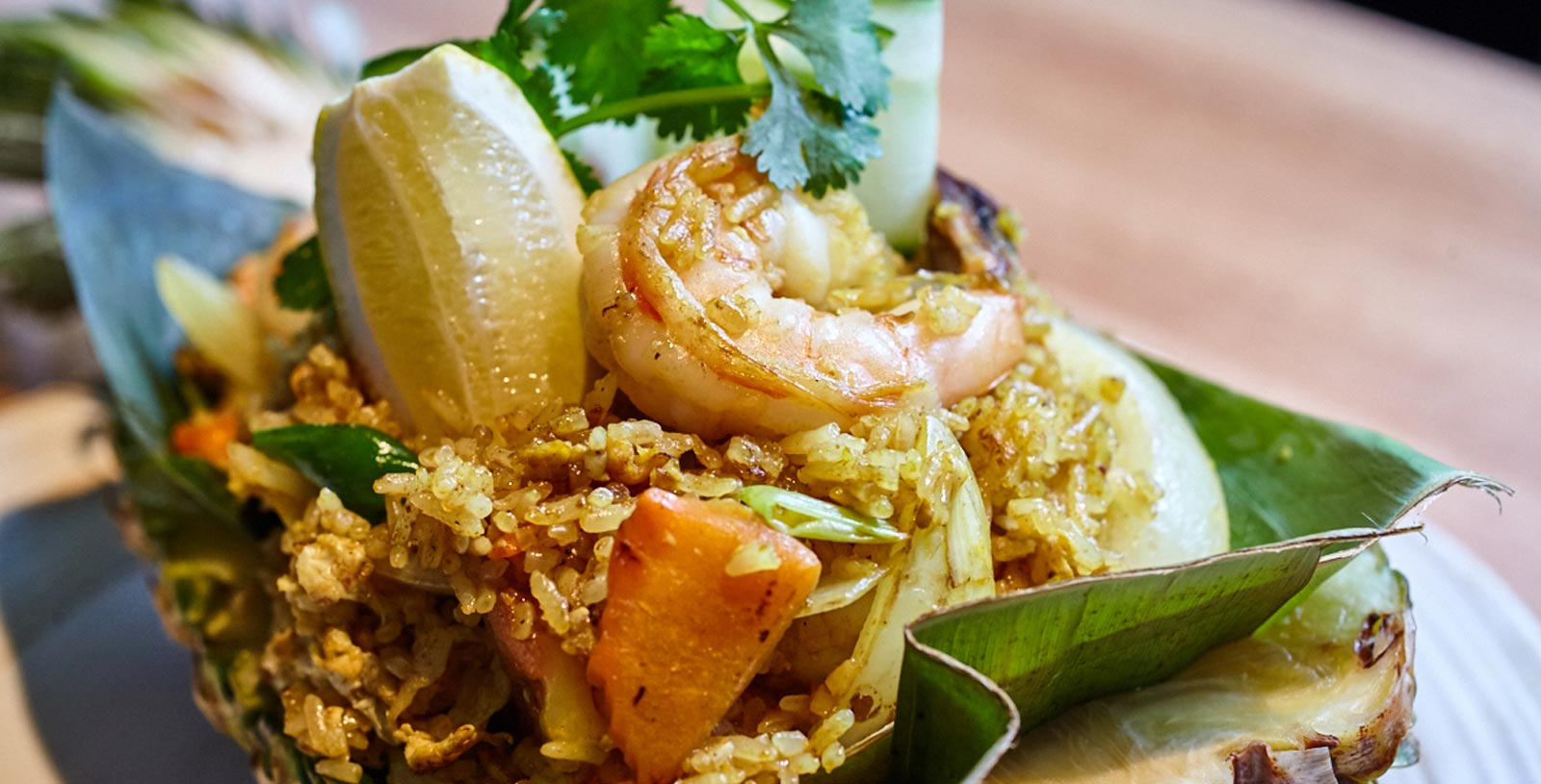 Pineapple fried rice with shrimp served in whole pineapple